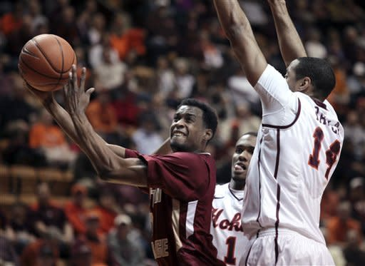 Boston College's Matt Humphrey, left, shoots past Virginia Tech's Victor Davila, right, during the first half of an NCAA college basketball game Sunday, Feb. 12, 2012, in Blacksburg, Va. (AP Photo/The Roanoke Times, Matt Gentry)