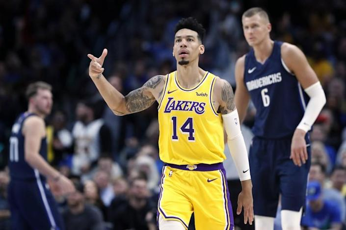 Los Angeles Lakers' Danny Green (14) celebrates sinking a basket as Dallas Mavericks' Kristaps Porzingis (6) stands nearby during the second half of an NBA basketball game in Dallas, Friday, Nov. 1, 2019. (AP Photo/Tony Gutierrez)