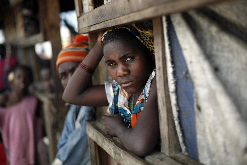 An internally displaced Congolese woman waits for food to be distributed by WFP at the Mugunga 3 camp outside the eastern Congolese town of Goma, Sunday, Dec. 2, 2012. Rebels say they will take back Congo's city of Goma if the government does not agree to negotiate with them by Monday. The M23 rebels completed their withdrawal of the eastern Congo city on Saturday, in compliance with an agreement reached between the rebel group and a regional body. (AP Photo/Jerome Delay)