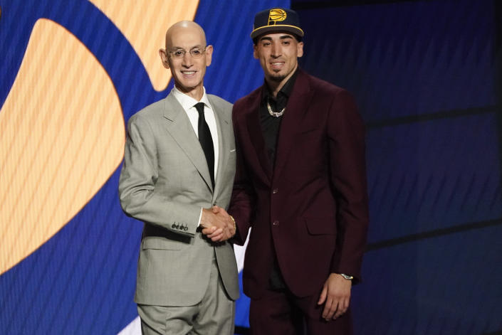Chris Duarte, right, poses for a photo with NBA Commissioner Adam Silver after being selected as the 13th overall pick by the Indiana Pacers during the NBA basketball draft, Thursday, July 29, 2021, in New York. (AP Photo/Corey Sipkin)