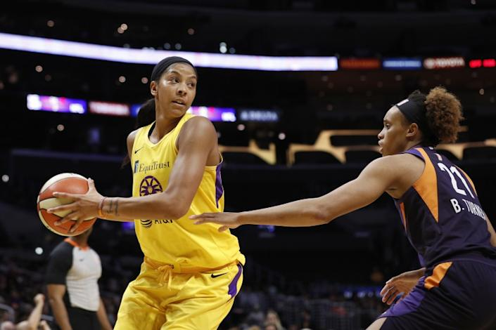 """Sparks forward Candace Parker, defended by Phoenix Mercury forward Brianna Turner, looks to pass at Staples Center on Aug. 8, 2019. <span class=""""copyright"""">(Meg Oliphant / Getty Images)</span>"""