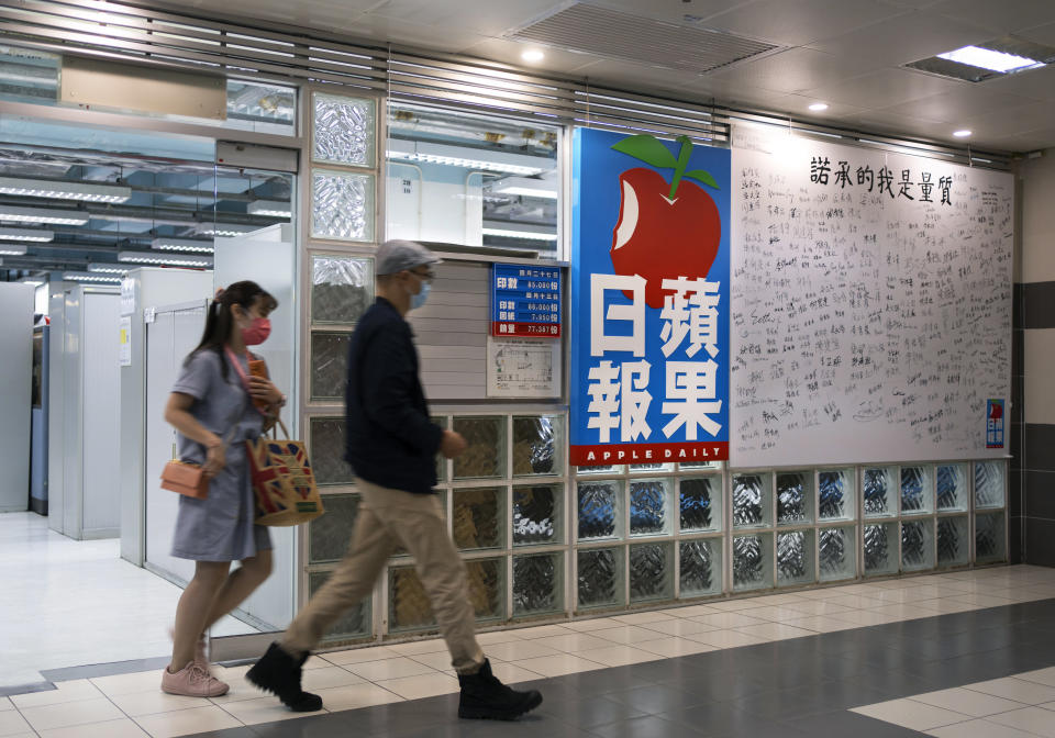A signing broad of stuffs are displayed at the lift lobby outside the news room of Apple Daily Monday, April 26, 2021, in Hong Kong. A newspaper that has advocated for greater democracy in Hong Kong came under further pressure Thursday, June 17, 2021, with the arrests of three top editors and two senior executives. (AP Photo/Vincent Yu)
