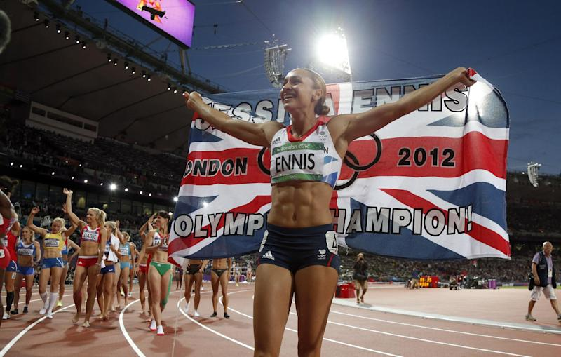 Britain's Jessica Ennis celebrates winning the gold in the women's heptathlon during athletics competition in the Olympic Stadium at the 2012 Summer Olympics, Saturday, Aug. 4, 2012, in London. (AP Photo/Matt Dunham)