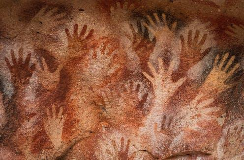"""<span class=""""caption"""">Prehistoric hand paintings at the Cave of Hands in Argentina, thought to be over 10,000 years old </span> <span class=""""attribution""""><a class=""""link rapid-noclick-resp"""" href=""""https://www.shutterstock.com/image-photo/prehistoric-hand-paintings-cave-hands-spanish-1634481835"""" rel=""""nofollow noopener"""" target=""""_blank"""" data-ylk=""""slk:R.M. Nunes/Shutterstock"""">R.M. Nunes/Shutterstock</a></span>"""