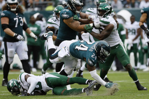 Philadelphia Eagles' Jordan Howard (24) is tackled by New York Jets' Marcus Maye (20) during the second half of an NFL football game, Sunday, Oct. 6, 2019, in Philadelphia. (AP Photo/Michael Perez)
