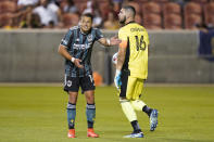 Los Angeles Galaxy's Chichartio, left, reacts after Vancouver Whitecaps goalkeeper Maxime Crepeau (16) makes a save in the second half during an MLS soccer match Wednesday, June 23, 2021, in Sandy, Utah. (AP Photo/Rick Bowmer)