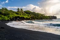 """<p><strong>Best camping in Hawaii:</strong> Wai'anapanapa State Park</p> <p>Sure, <a href=""""https://www.cntraveler.com/story/how-to-see-the-lava-flow-in-hawaii-volcanoes-national-park?mbid=synd_yahoo_rss"""" rel=""""nofollow noopener"""" target=""""_blank"""" data-ylk=""""slk:Hawaii's national parks"""" class=""""link rapid-noclick-resp"""">Hawaii's national parks</a> get all the fuss, but we'll take the rugged seclusion, natural lava arches, and <a href=""""https://www.cntraveler.com/gallery/most-beautiful-black-sand-beaches-in-the-world?mbid=synd_yahoo_rss"""" rel=""""nofollow noopener"""" target=""""_blank"""" data-ylk=""""slk:black sand beaches"""" class=""""link rapid-noclick-resp"""">black sand beaches</a> of Wai'anapanapa State Park any day. What the park lacks in amenities (there's only outdoor showers, picnic tables, and a bathroom), it makes up for in raw beauty. Park your van or tent and take in the sunrise from the boulder-strewn coastline where the tangled, green jungle meets the sea.</p>"""