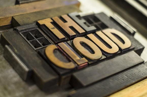 Close-up picture of a newspaper printing  screen that says the cloud.