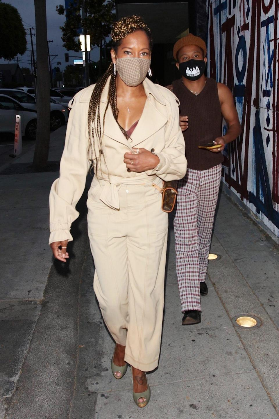 <p>Regina King shows off her street style in a tan jumpsuit and gingham face mask as she heads to dinner with friends at Craig's in West Hollywood on Wednesday.</p>