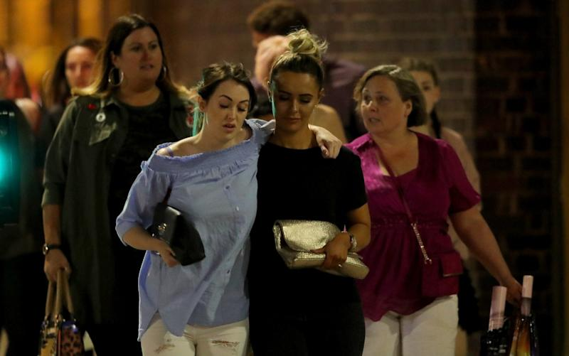 Police escort members of the public from the Manchester Arena - Credit: Getty
