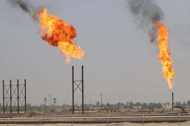 Crude oil prices sink while gasoline soars