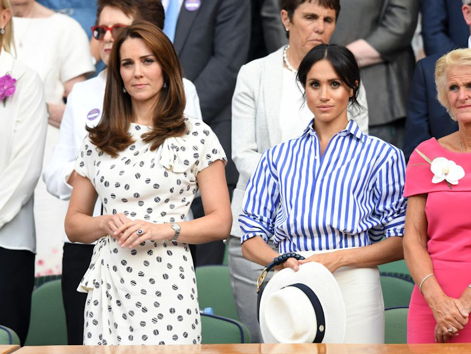 Catherine, Duchess of Cambridge and Meghan, Duchess of Sussex attend day twelve of the Wimbledon Tennis Championships at the All England Lawn Tennis and Croquet Club on July 14, 2018 in London, England.