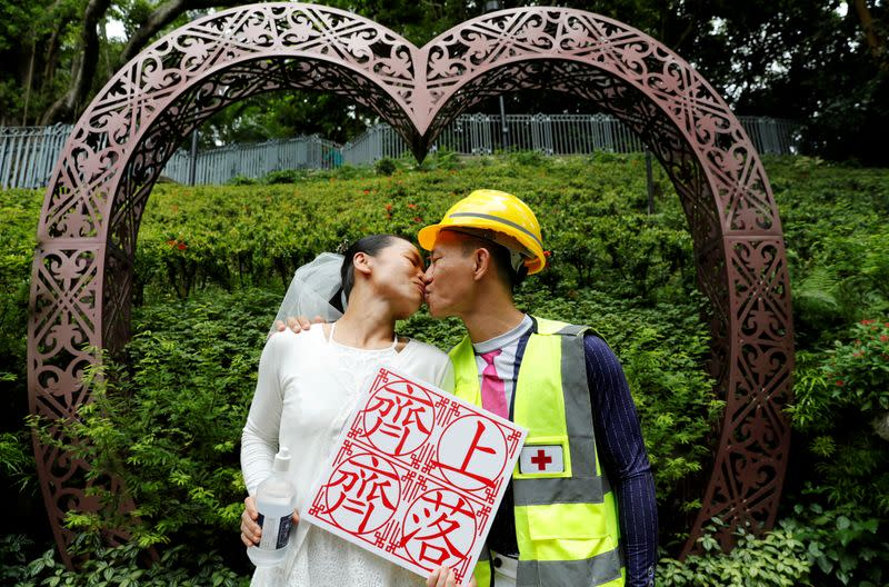 On trial on riot charges, Hong Kong newlyweds prepared for life apart