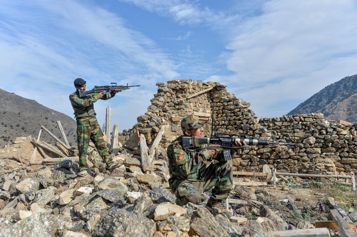 In this photograph taken on November 25, 2019, Afghan security forces take part in an ongoing operation against Islamic State (IS) militants in the Achin district of Nangarhar province. (Noorullah Shirzada/AFP via Getty Images)