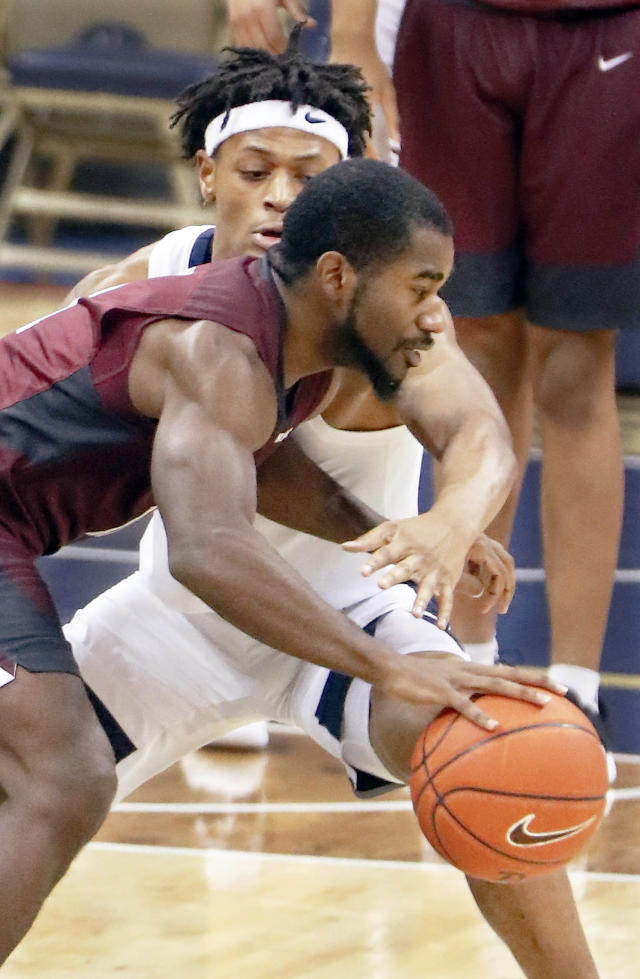 Maryland Eastern Shore's Ahmad Frost tries to get past Pittsburgh's Au'Diese Toney as he defends during the first half of an NCAA college basketball game, Saturday, Dec. 15, 2018, in Pittsburgh. (AP Photo/Keith Srakocic)