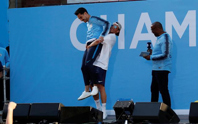Soccer Football - Premier League - Manchester City Premier League Title Winners Parade - Manchester, Britain - May 14, 2018 Manchester City's Ilkay Gundogan and Leroy Sane celebrate on stage during the parade Action Images via Reuters/Andrew Boyers