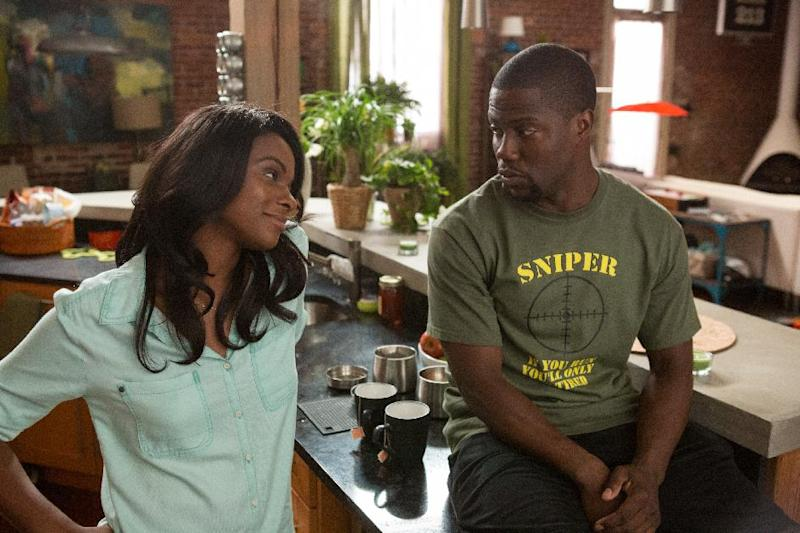 "This image released by Universal Pictures shows Tika Sumpter, left, and Kevin Hart in a scene from ""Ride Along."" (AP Photo/Universal Pictures, Quantrell D. Colbert)"