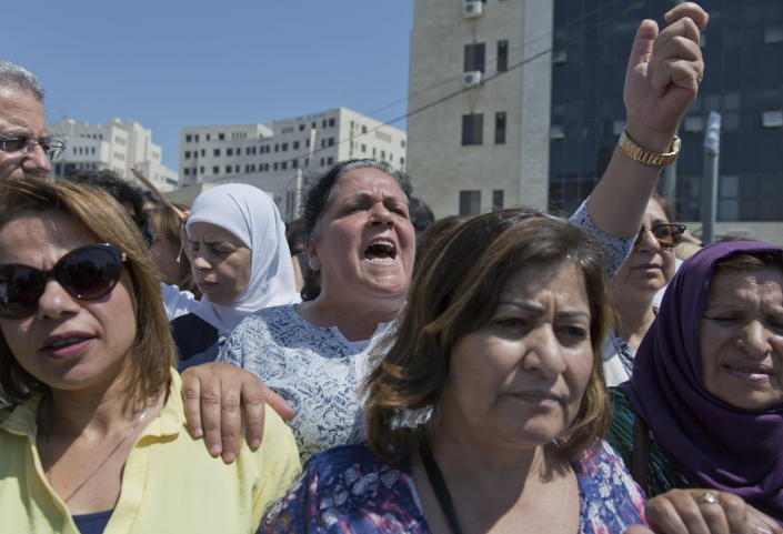 A Palestinian woman chants slogans during a rally in front of the Prime Minister's office, in the West Bank city of Ramallah, Monday, Sept. 2. 2019. Hundreds of Palestinian women have protested in front of the prime minister's office to demand an investigation into the death of Israa Ghrayeb, a 21-year-old woman whom many suspect was the victim of a so-called honor killing. (AP Photo/Nasser Nasser)