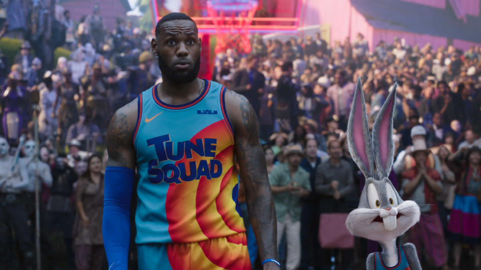 LeBron James and Bugs Bunny stand beside each other in Tune Squad jerseys