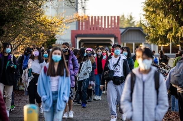 The Island Health Authority is asking students and staff to consider wearing masks at all times indoors, including when seated apart from others, as well as outdoors when they are close to others. (Ben Nelms/CBC - image credit)