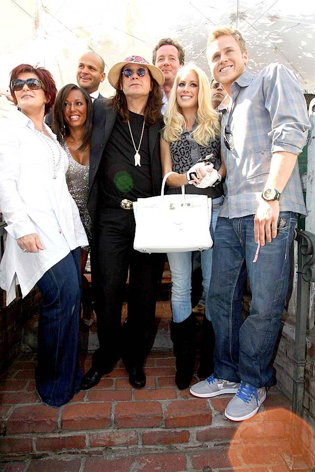 "The lunch bunch, which includes Sharon Osbourne, Mel B. and her hubby Stephan Belafonte, Ozzy, ""America's Got Talent"" judge Piers Morgan, Heidi, and Spencer, poses for a bizarre group shot upon exiting the trendy restaurant. <a href=""http://www.infdaily.com"" target=""new"">INFDaily.com</a> - September 7, 2008"