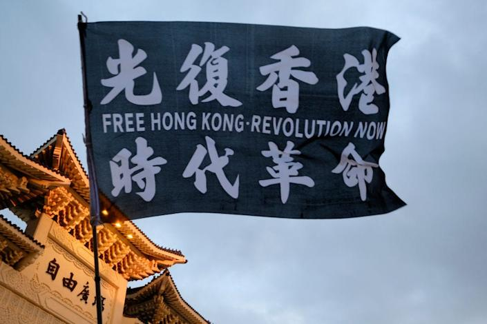 "A flag saying ""Free Hong Kong, Revolution Now"" waved in front of Taipei's Chiang Kai-shek memorial."