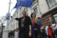 A woman waves a EU flag as the other holds an old Belarusian national flag during an opposition rally to protest the official presidential election results in Minsk, Belarus, Saturday, Sept. 5, 2020. Women's marches and demonstrations have become a regular feature of the four weeks of protest that have shaken Belarus following a disputed election that gave Belarusian President Alexander Lukashenko a sixth term in office. (AP Photo)