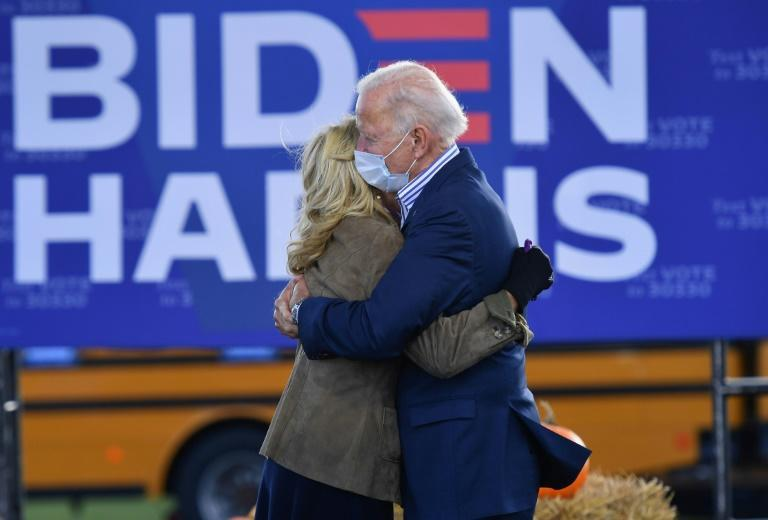 Democratic presidential candidate Joe Biden and his wife Jill hug during a Drive-In rally where he hammered the current administration's handling of the pandemic