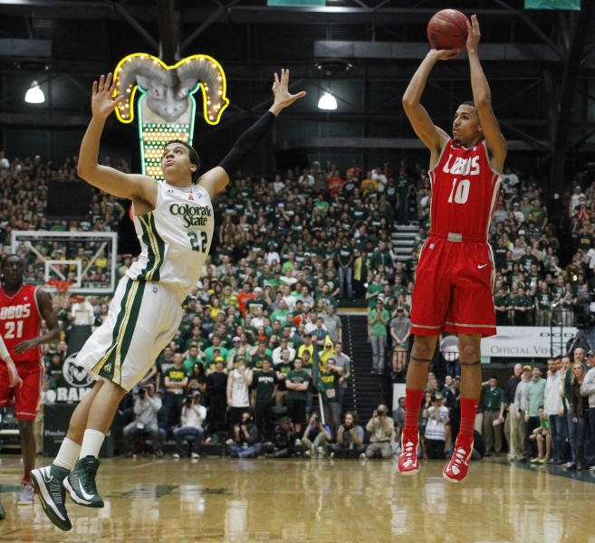 New Mexico guard Kendall Williams, right, takes a shot over Colorado State guard Dorian Green in the first half of New Mexico's 91-82 victory in an NCAA basketball game in Fort Collins, Colo., on Saturday, Feb. 23, 2013. Williams scored 46 points in the game, which set a new single-game point record for Moby Arena since it opened in 1966. (AP Photo/David Zalubowski)