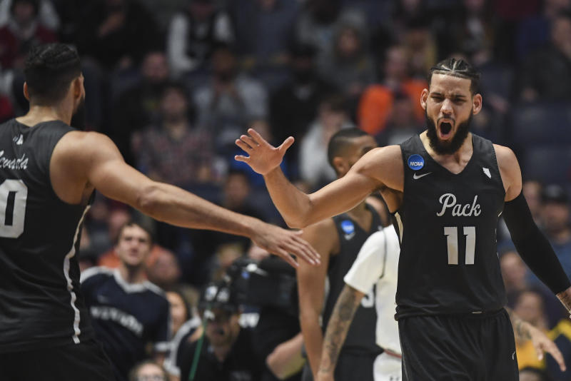 Nevada coach rips off shirt after upset comeback over Cincinnati — March Madness