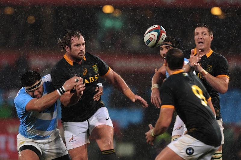 South Africa's Jannie du Plessis (L), Bakkies Botha (R) and Ruan Pienaar (C) during the Rugby Championship Test match against Argentina in Pretoria on August 16, 2014