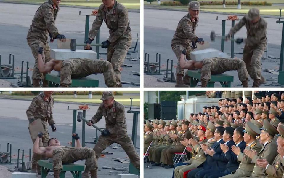 In one part of the video, a man lies on a bed of nails and has concrete blocks smashed into his chest – which is greeted with wild applause from the attending military dignitaries