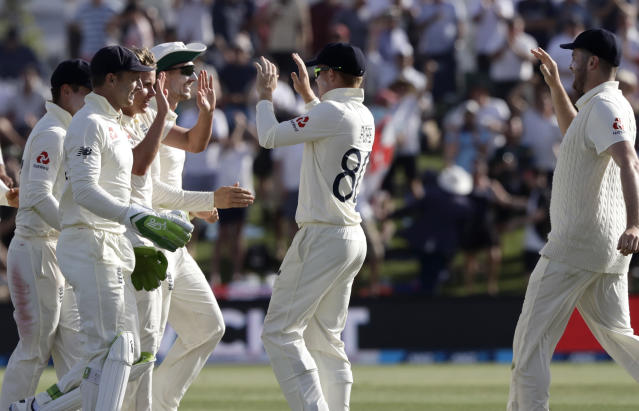England players celebrate the dismissal of New Zealand's Kane Williamson during play on day two of the first cricket test between England and New Zealand at Bay Oval in Mount Maunganui, New Zealand, Friday, Nov. 22, 2019. (AP Photo/Mark Baker)