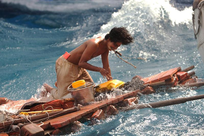 "This publicity photo released by 20th Century Fox shows Suraj Sharma as Pi Patel battling the forces of nature at sea in a scene from the film, ""Life of Pi."" The film is based on the best-selling novel by Canadian author Yann Martel, a globe-trotting writer born in Spain. (AP Photo/20th Century Fox, Peter Sorel)"