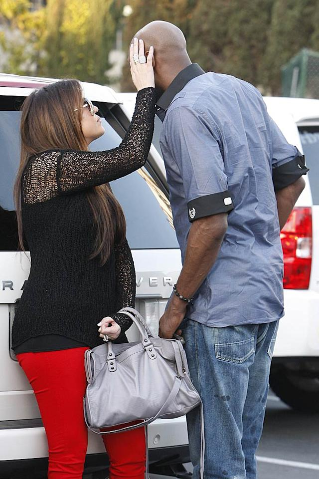 "Perhaps Khloe is making sure her main squeeze shaved his head this morning? <a href=""http://www.infdaily.com"" target=""new"">INFDaily.com</a> - March 15, 2011"