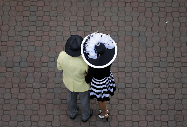 Fans watch a race before the 140th running of the Kentucky Derby horse race at Churchill Downs Saturday, May 3, 2014, in Louisville, Ky. (AP Photo/Charlie Riedel)