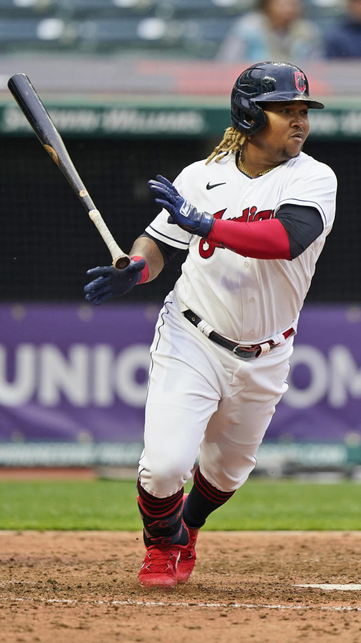 Cleveland Indians' Jose Ramirez watches his ball after hitting a single in the ninth inning of a baseball game against the Kansas City Royals, Monday, April 5, 2021, in Cleveland. (AP Photo/Tony Dejak)