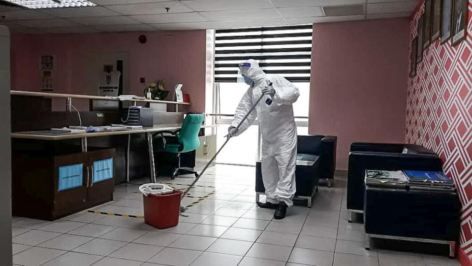 A worker sanitises the Seberang Perai Municipal Council building after one of its staff tested positive for Covid 19. — Picture courtesy of MBSP