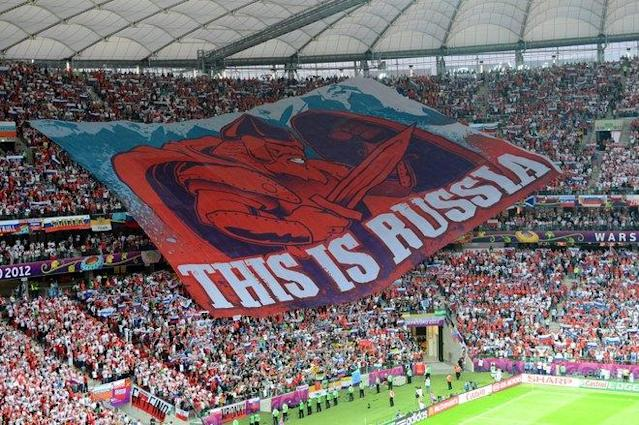 TOPSHOTS Russia's football fans display a giant banner during the Euro 2012 championships football match Poland vs Russia on June 12, 2012 at the National Stadium in Warsaw. AFP PHOTO / DIMITAR DILKOFFDIMITAR DILKOFF/AFP/GettyImages