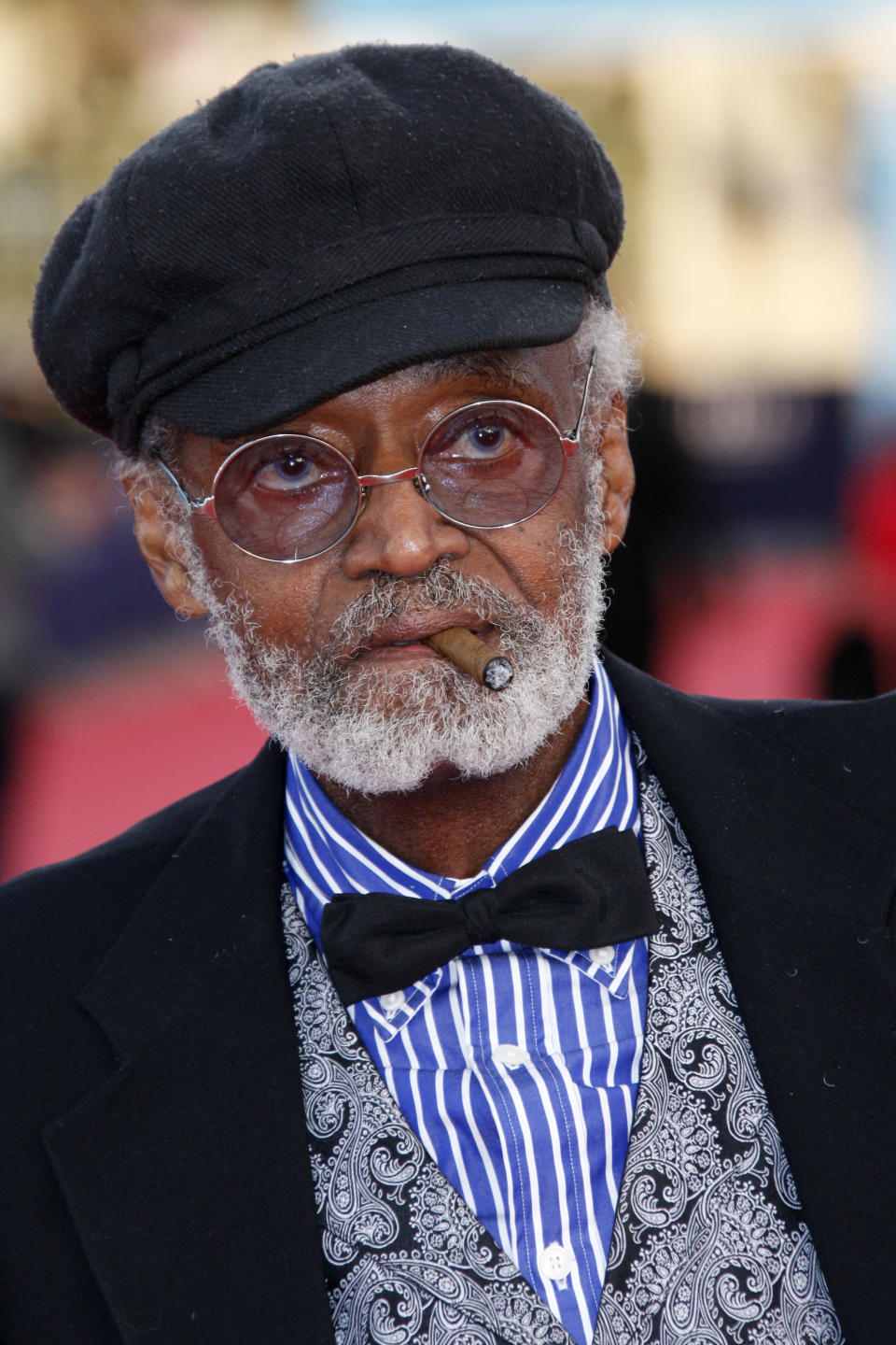 """FILE - U.S director, actor, screenwriter Melvin Van Peebles is seen during a tribute for his career at the 38th American Film Festival in Deauville, Normandy, France, Wednesday Sept. 5, 2012. Van Peebles, a Broadway playwright, musician and movie director whose work ushered in the """"blaxploitation"""" films of the 1970s, has died at age 89. His family said in a statement that Van Peebles died Tuesday night, Sept. 21, 2021, at his home. (AP Photo/Michel Spingler, File)"""