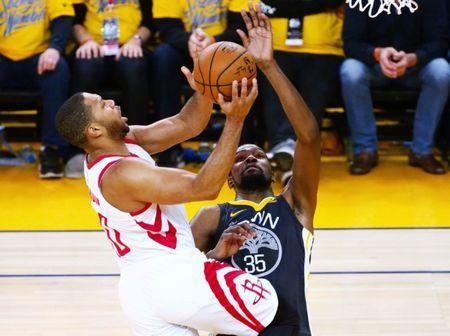 May 22, 2018; Oakland, CA, USA; Houston Rockets guard Eric Gordon (10) shoots over Golden State Warriors forward Kevin Durant (35) during the third quarter in game four of the Western conference finals of the 2018 NBA Playoffs at Oracle Arena. Mandatory Credit: Kelley L Cox-USA TODAY Sports