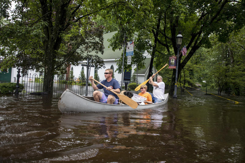 Todd Allen, his dog Rusty with his aunt Betty and uncle Roger Allen, right, of Vincentown, N.J., canoe along flooded roads after heavy rain fell on the area Thursday June 20, 2019. Severe storms containing heavy rains and strong winds have spurred flooding in the suburbs of Philadelphia. (Photo: Tyger Williams/The Philadelphia Inquirer via AP)