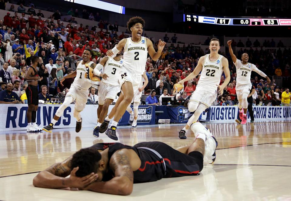 Michigan's Jordan Poole (2) celebrates with teammates after his game-winning shot to oust Houston from the 2018 NCAA tournament. (Getty)