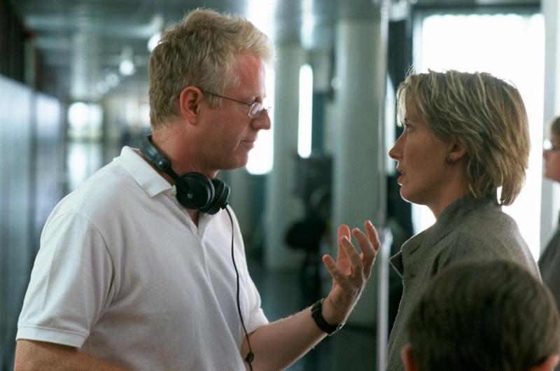 Richard Curtis and Emma Thompson on the set of Love Actually in 2002. (Photo: Moviestore/Shutterstock)