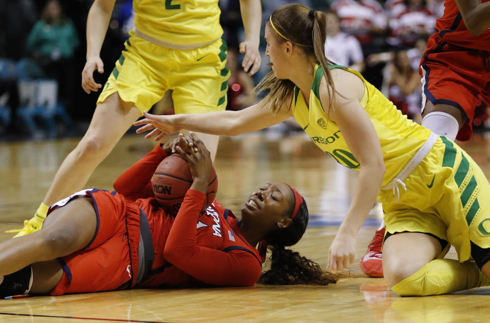Oregon's Sabrina Ionescu, right, and Arizona's Destiny Graham scramble for the ball during the first half of an NCAA college basketball game at the Pac-12 women's tournament Friday, March 8, 2019, in Las Vegas. (AP Photo/John Locher)