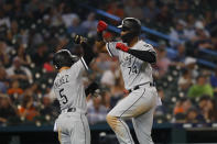Chicago White Sox's Eloy Jimenez (74) celebrates his grand slam with Yolmer Sanchez (5) during the fourth inning of the team's baseball game against the Detroit Tigers in Detroit, Friday, Sept. 20, 2019. (AP Photo/Paul Sancya)
