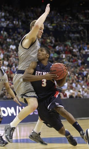 Belmont's Kerron Johnson, right, drives to the basket against Georgetown's Nate Lubick during the first half of an NCAA college basketball tournament second-round game Friday, March 16, 2012, in Columbus, Ohio. (AP Photo/Jay LaPrete)
