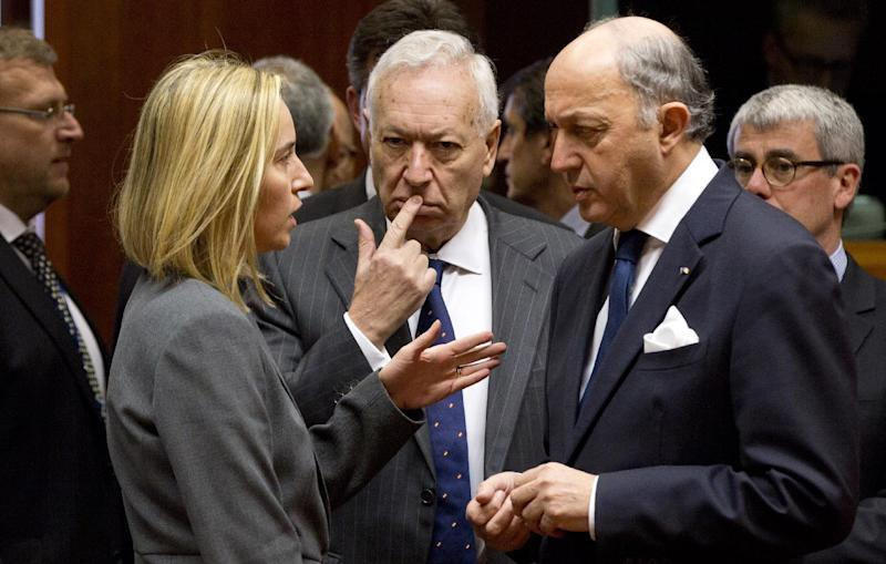 From second left, Italian Foreign Minister Federica Mogherini, Spanish Foreign Minister Jose Manuel Garcia-Margallo and French Foreign Minister Laurent Fabius, speak with each other during an emergency meeting of EU foreign ministers at the EU Council building in Brussels on Monday, March 3, 2014. EU foreign ministers meet Monday, in emergency session, to discuss the ongoing crisis in Ukraine. (AP Photo/Virginia Mayo)