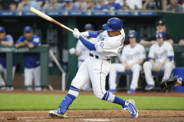 Kansas City Royals' Jon Jay hits an RBI-single in the third inning of a baseball game against the New York Yankees at Kauffman Stadium in Kansas City, Mo., Friday, May 18, 2018. (AP Photo/Colin E. Braley)