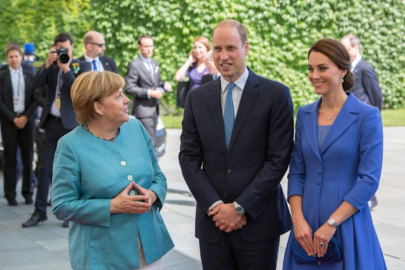 German Chancellor Angela Merkel welcomes Prince William, Duke of Cambridge and Catherine, the Duchess of Cambridge in the German Chancellery in Berlin on July 19.